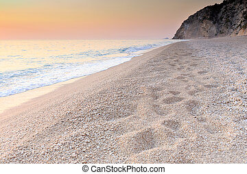 Pebble beach at dawn in Lefkada, Greece - Pebble beach at...