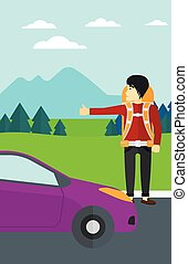 Young man hitchhiking - An asian man hitchhiking trying to...