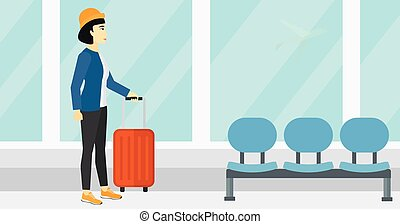 Woman at airport with suitcase.