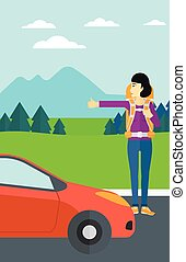 Young woman hitchhiking - An asian woman hitchhiking trying...