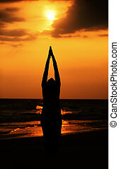 Sun salutation - A yoga practitioner performs sun salutation...