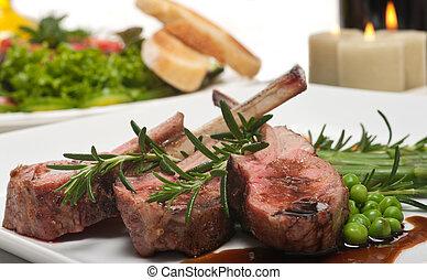 Lamb Chop and Salad - Lamb chop, salad and wine