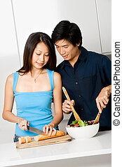 Couple Preparing Meal - A good looking couple preparing a...