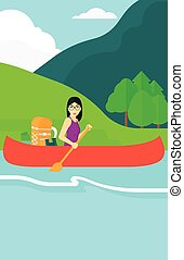 Woman canoeing on the river - An asian woman canoeing on the...