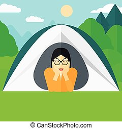 Woman lying in tent. - An asian woman crawling out from a...