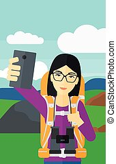 Backpckaer making selfie. - An asian woman making selfie on...