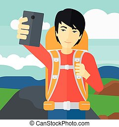 Backpckaer making selfie. - An asian man making selfie on...