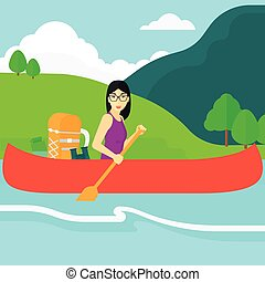 Woman canoeing on the river. - An asian woman canoeing on...