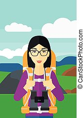 Cheerful backpacker with binoculars. - An asian woman with...