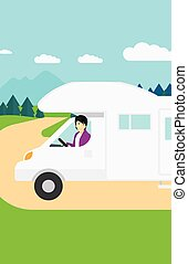Man driving motor home - An asian man driving a motor home...