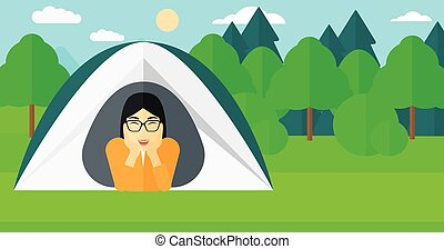 Woman lying in tent - An asian woman crawling out from a...