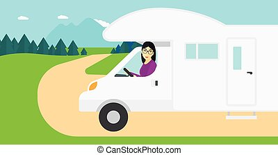 Woman driving motor home - An asian woman driving a motor...