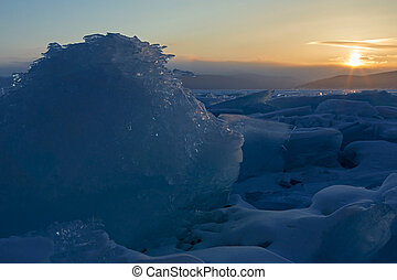 Sun rises over the ice floes.