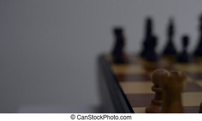 Wooden Chessboard slow camera trucking right close-up -...