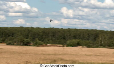 Flight vehicle aerial shot. - Piloted flight vehicle above...