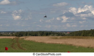 Flight vehicle aerial shot. - Piloted flight vehicle landing...