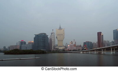 Timelapse of skyline of Macau city at Nam Van Lake - MACAU -...
