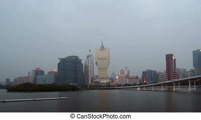 Timelapse of skyline of Macau city at Nam Van Lake - MACAU -...