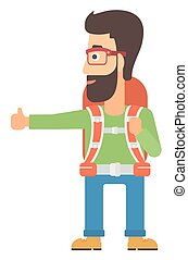 Young man hitchhiking - A hipster man with the beard...