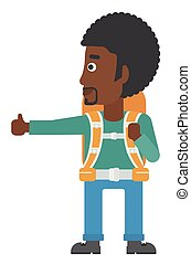 Young man hitchhiking - An african-american man hitchhiking...