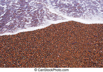 Red sand on the beach of Santorini, Greece - Famous red sand...