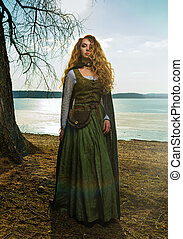 Woman with long curly hair on the lake Green historical...
