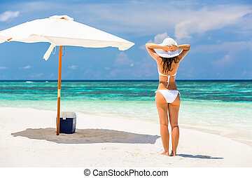 Young woman on the beach - Young woman enjoing sun on the...