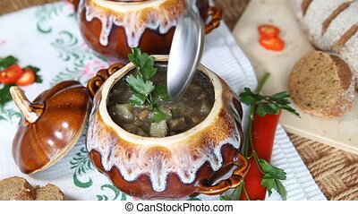 On holiday table pot with meatless soup Scoop up full spoon...