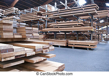 Lumber industry - packed warehouse with wood ready for...