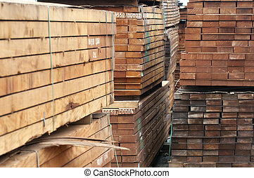 Lumber industry - piled up wood ready for transport at a...