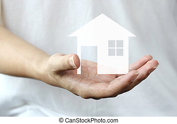 hand holding a house