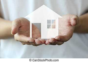 hand holding a house background