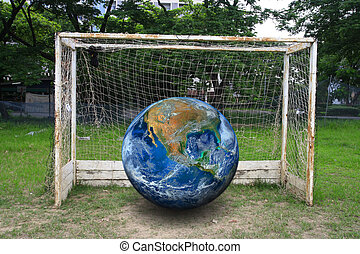 the earth on soccer goal, including elements furnished by...