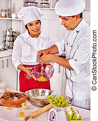 Professional chefs cook in the kitchen Happy woman and man...