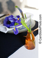Table setting with blue anemones