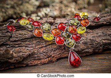 Colorful stones necklace on wooden surface