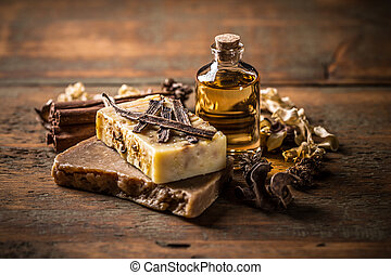 Handmade soap with cinnamon and vanilla on a wooden...