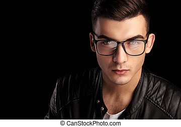 closeup shaved macho in black leather wearing glasses -...