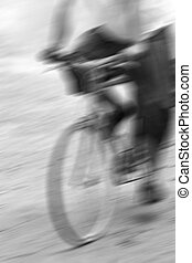 motion blurred ride bicycle on road