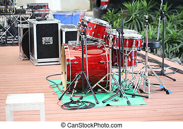 red drums on stage, music festival