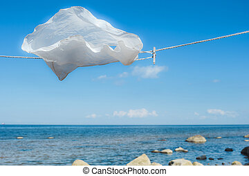 White top shirt - White shirt hanging on a rope on the...