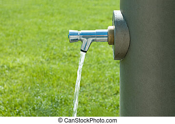 public drinking fountain - water flowing from a public...