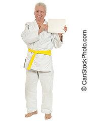 Karate Senior man with poster - Karate Senior man with white...