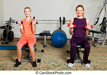 Two Young Women in Gym