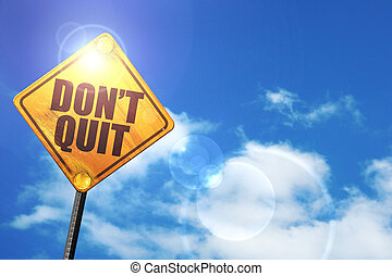 Yellow road sign with a blue sky and white clouds: don't quit