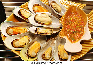 shelled mussel roasted with spicy sauce , Thai food -...