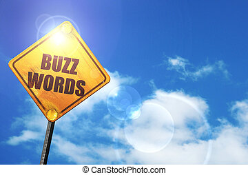 Yellow road sign with a blue sky and white clouds: buzzword