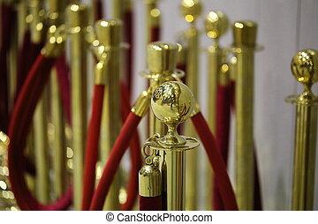 Gold stanchion posts , cinema - Gold stanchion posts, cinema...