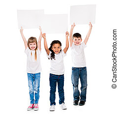 three cheeerful children holding en empty paper sheet above...
