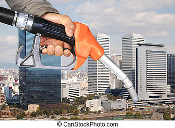 oil pump nozzle and high building city view background
